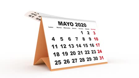 monthly sheets passing in a desk calendar for 2020. new year 2020 calendar in spanish. Week starts on monday Stock mozgókép