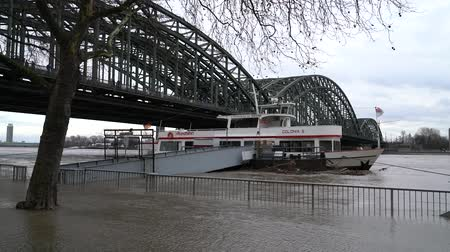 wetness : COLOGNE, GERMANY - JANUARY 7, 2018: High water on the Rhine Rhine river in Cologne on January 7, 2018 in Germany