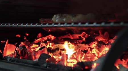 bbq grill : Steak and cutlet of minced meat for the burger prepared and flipped on the grill in the restaurant Stock Footage