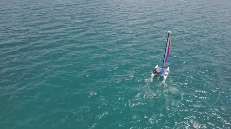 tek başına : BACALAR, MEXICO, 05 OCTOBER 2017: Catamaran sailing in blue waters - shot from drone