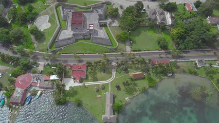fortress : Tilt up shot from drone: aerial view to Bacalar city, Fort San Felipe Bacalar and lagoon