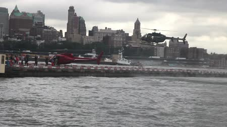 heliport : People boarding helicopters for sightseeing in New York Stock Footage