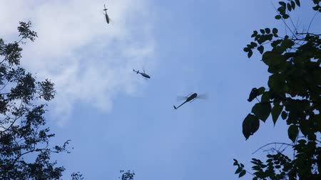 copter : Three ambulance helicopters on rescue mission over the forest, with sound