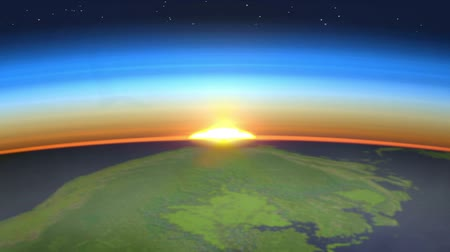 new world : Colorful and realistic sunrise with starfield as seen from space, with clouds and morning mist. Focus is on the sky hence the earth surface is blurred out