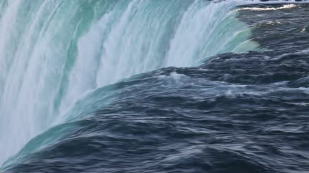 birds flying : Top of Canadian horseshoe Niagara falls closeup , with bird flying over