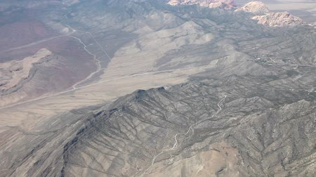 samoloty : Aerial view from an airplane over NevadaCalifornia somewhere in between Las Vegas and San Francisco, timelapse