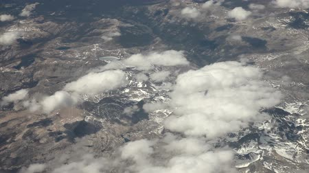bílé mraky : Aerial view from an airplane over NevadaCalifornia somewhere in between Las Vegas and San Francisco, timelapse