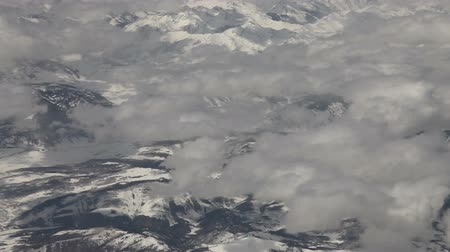 Flying  above snowy mountains and clouds