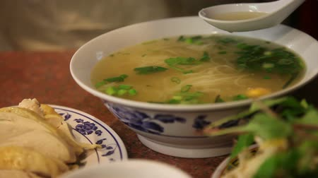 meal : Traditional Vietnam Pho Ga (chicken noodle soup) with someone eating it. Stock Footage