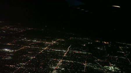 night scene : Aerial view of Los Angeles at night from an airplane just before it lands Stock Footage