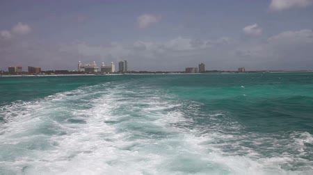 On a boat trip off coast Aruba, the Caribbean, view from the rear of the boat.