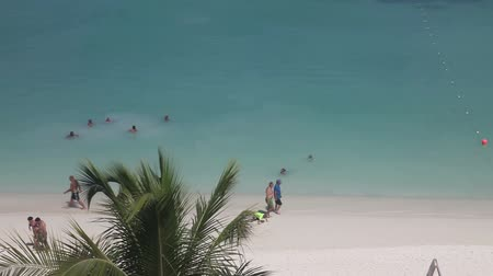 Palm beach, Aruba, the Caribbean,  people walking, jogging, swimming, kids playing with sand, view from above.