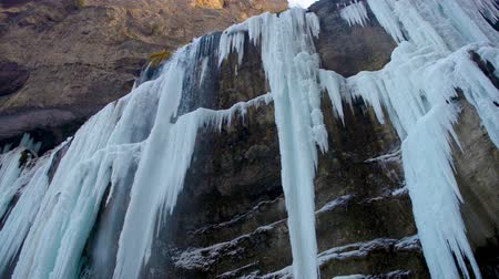 icefall : hight frozen waterfall with ice in blue and white color in winter