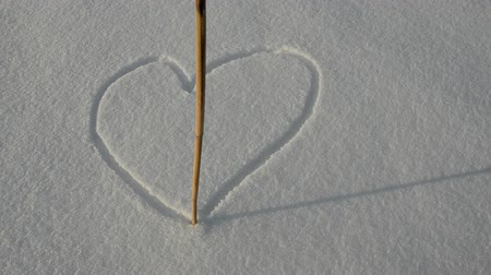 kavramsal : drawing many love hearts on winter snow