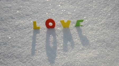 valentin nap : colorful Valentine day word love on February snow