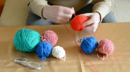 babcia : Grandmother hands winding thread on a ball