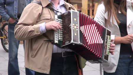 piano parts : man in a fair playing with vintage accordion in street