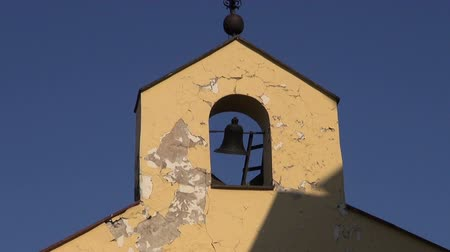 torre sineira : old church bell tower with black bell and cross