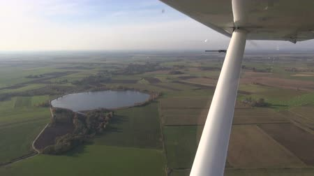 bird's eye view : aerial view over autumn time  lake and fields
