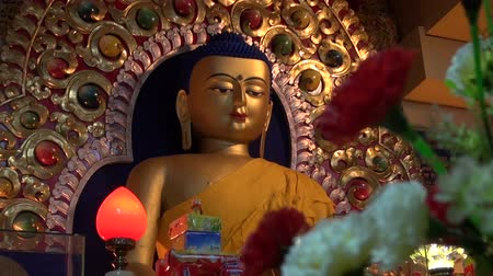 sürgün : golden Buddha statue in Dharamsala temple,Himachal Pradesh,India