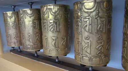 sürgün : beautiful Tibetan buddhist prayer brass wheels in Dharamsala, Himachal Pradesh, India Stok Video