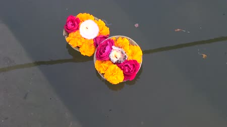 puja : hinduism religious ritual puja flowers and candle on Ganges water, India