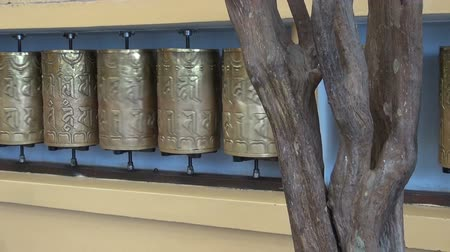 sürgün : beautiful buddhist prayer wheels in motion,Dharamsala,India