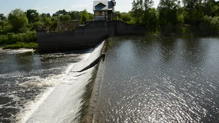 summer river dam water overflow
