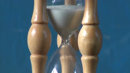 time flow : Time concept – sand motion in sandglass, hourglass,sand clock