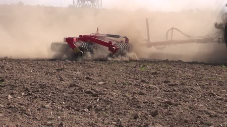 farm equipment : agriculture tractor on autumn farm field with cultivator Stock Footage