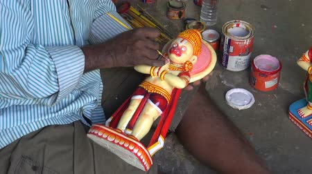 incarnation : India, Odisha, Puri – December 29: indian craftsman in Puri paint new Lord Jaganath statue,December 29, 2013 Puri, Odisha, India