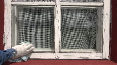 arruela : cleaning old window in farm house Stock Footage