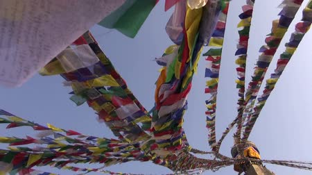bodhnath : ancient Boudhanath stupa with buddhist flags and camera rotate, Katmandu, Nepal Stock Footage