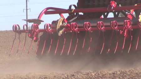 farm equipment : agriculture tractor on  farm field seeding  grains