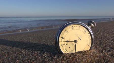 perdido : analog pocket vintage clock on wet sea ocean resort beach sand