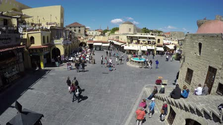 rhodes : RHODES, GREECE - CIRCA 2015 April: People tourists walk in Rhodes old town square. UNESCO world  heritage. Timelapse 4K, Rhodes island, Greece
