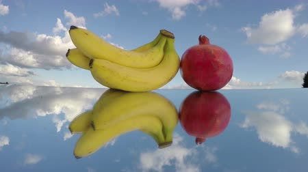 gerçeküstü : Three bananas and pomegranate reflected on a mirror, timelapse 4K