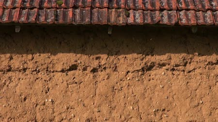 terracota : Clay wall of an old farm barn in rural area