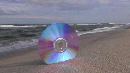 compact disc : Seascape with CD in the resort beach sand