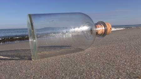 perdido : Seascape with transparent bottle in the sand
