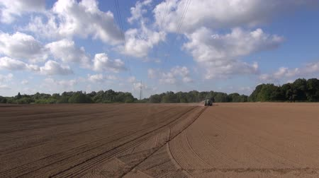 fruitful : Tractor working sowing crop in the field in rural area