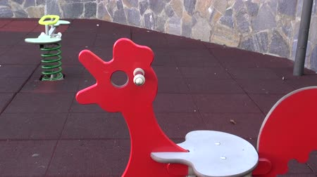 playfield : Children playground equipment with spirals in leisure area by the stone wall