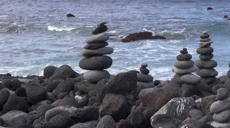 stacked rock : Decoratively stacked round lava stones on the beach by the sea