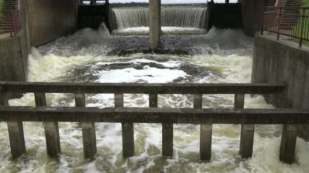 run down : Old river dam water splash overflow after autumn rains