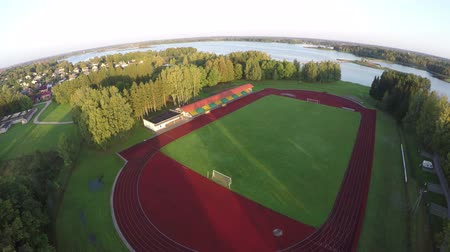 geniş açılı : Drone fly up over sport stadium in morning sunlight, aerial view
