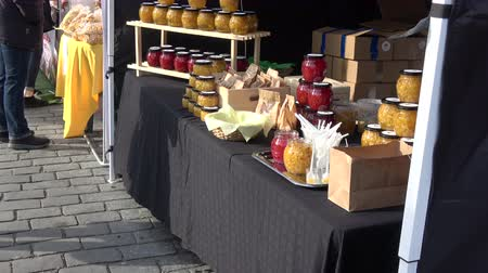 konserve : Many potted preserved fruits and vegetables glass jar in farmers street market
