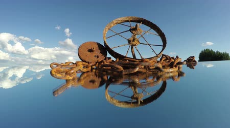 Rusty scrap-iron heap on mirror and clouds motion, time lapse Stockvideo