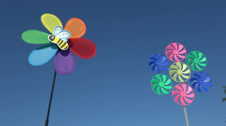propeller toy : Two beautiful decorative windmill toys on sky background
