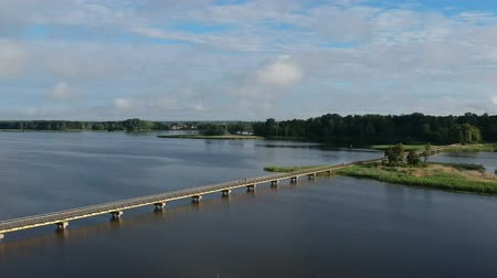 lake landscape with long wooden bridge, aerial view