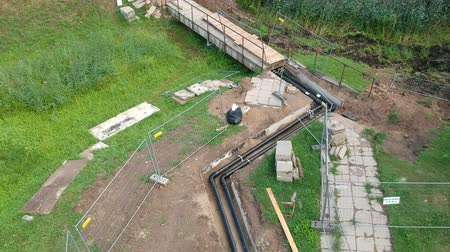 heating system : Heating system repair works. Trench and pipeline in park from drone, aerial Stock Footage